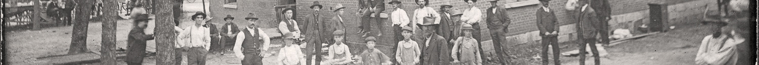 A group of men and boys gathered in front of the Polk County Courthouse in Dunnegan, Polk County, Missouri circa 1912.