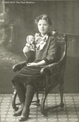 "Girl with German bisque character doll known as ""Kaiser"" and made by Kammer & Reinhardt (mold #100) about 1921"
